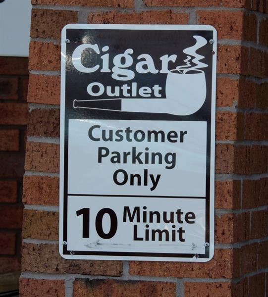 Aluminum parking sign for the Cigar Outlet