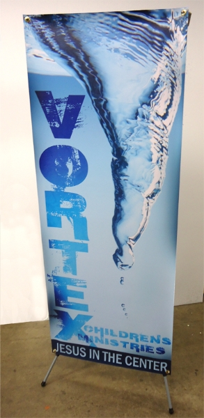 Vortex banner displayed on a banner stand.